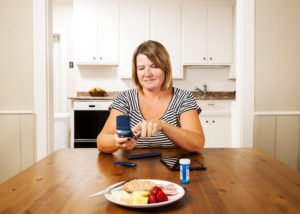 Checking blood sugar, glucose levels in the kitchen